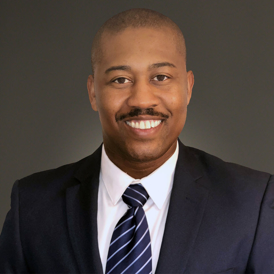 A headshot of Troy Elam, MBA