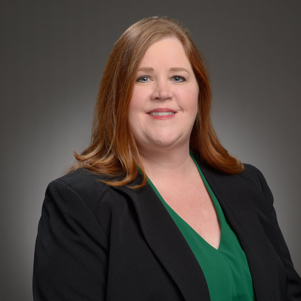 A headshot of Holly Evans, MBA