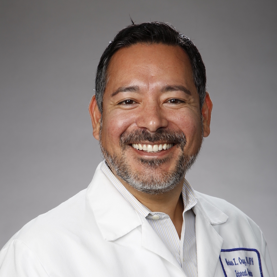 A headshot of Moises I. Cruz, MD, MPH