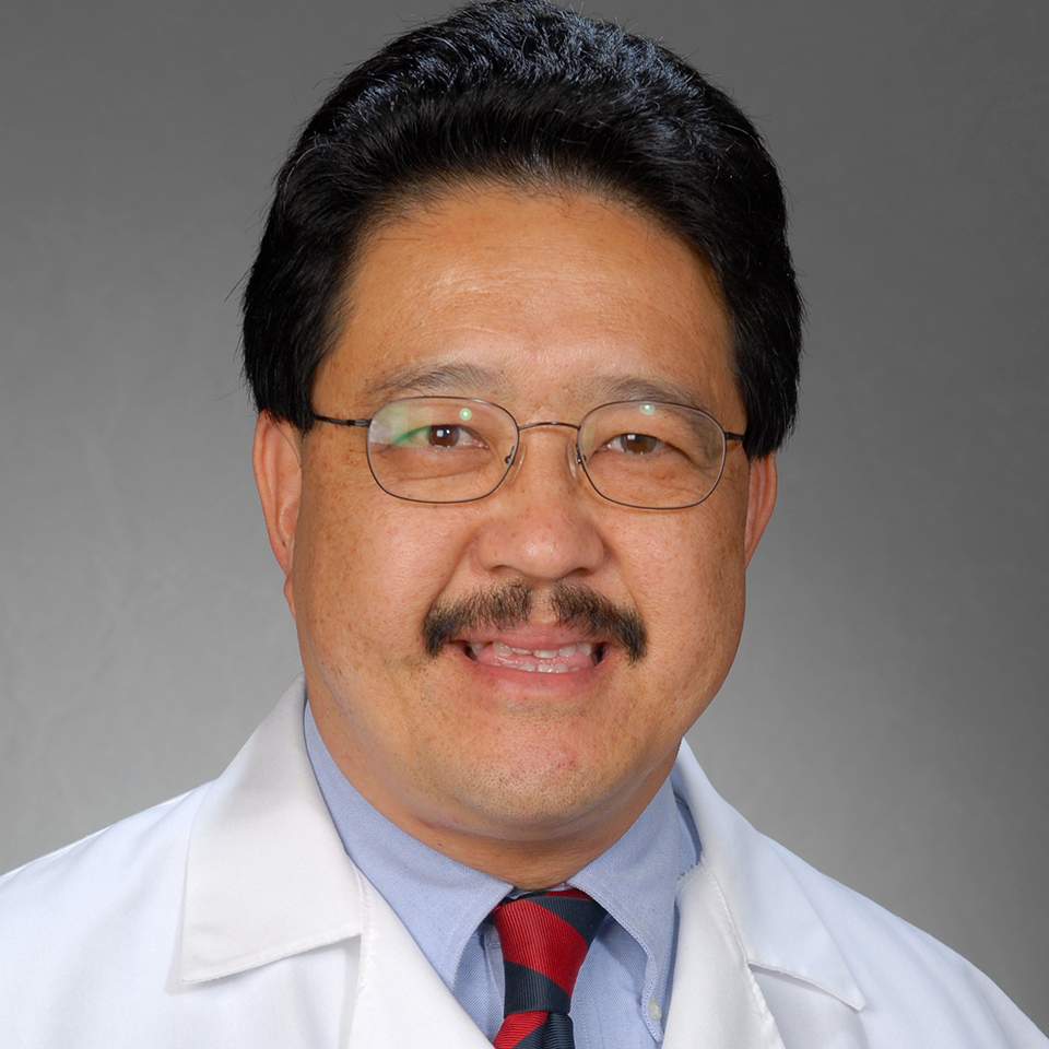 A headshot of Thomas Y. Tom, MD, FACP