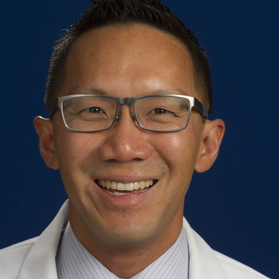 A headshot of Christopher Yue-Yun Woo, MD, MS, FACC
