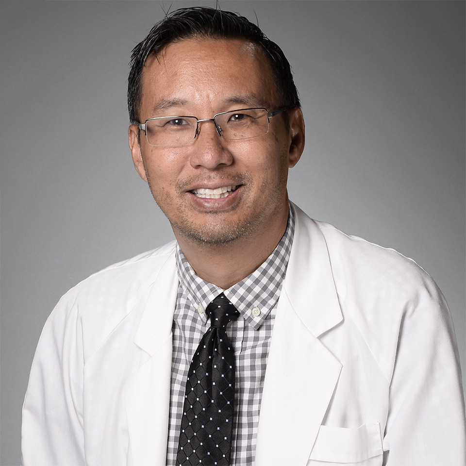 A headshot of Anson Yew, MD
